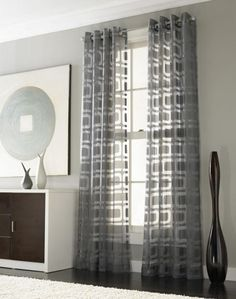 Drapery Ideas for the Modern Home:  Othello Modern Geometric Curtain Panel, featuring semi-sheer fabric in a Mid-Century modern design. Note how grommets at the top of the panels accommodate the drapery rod, creating rippled folds.