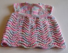 Free knitting pattern for a pretty babies dress in Old Shale Stitch,from The Knitting Wool Store Babies Dress Knitting Pattern knit this sweet little babies dress in Jeans Crazy cotton blend yarn with our free knitting pattern from The Knitting Wool Store Baby Dress Pattern Free, Baby Cardigan Knitting Pattern, Baby Knitting Patterns, Knitting Designs, Free Knitting, Knitting Wool, Free Pattern, Girls Knitted Dress, Knit Baby Dress