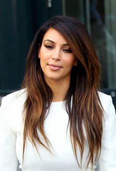"""Reality TV star Kim Kardashian looks chic and stylish with her subtle blonde ombre tips. For a classy and sophisticated ombre hair color, keep the highlighted sections subtle and soft. Color blocking is harsh and brash, so avoid """"lines"""" of clashing color and opt for soft, feathered highlights."""