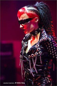 Futuristic Girl, Cyberpunk Girl, Futuristic Look, Cyber Goth, Cyber Glasses, Punk Hairstyle, Girl in Black, Red Hair, Goth Girl, punk girl, by FuturisticNews.com