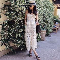"""@halliedaily's photo: """"While my little Red Bear enjoys his new Jelly Belly candy(on the bench in the rear). I enjoy the jasmine wall. #HappyMothersDay #love #family #ootd #outfit"""""""
