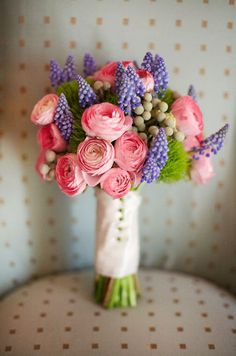 A sweet mix of pink ranunculus, purple muscari, and bright greens create a incredibly fun bouquet.