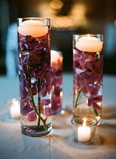 gorgeous plum orchids - floating candle wedding centerpiece ~  we ❤ this! moncheribridals.com