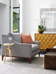 This contemporary-styled chair is an exceptional way to add plush comfort and a fashionable appeal to any living room. The chair's simple, sleek lines are highlighted by an exposed wood base rail for a pleasing textural contrast. Incredibly comfortable as well as chic.