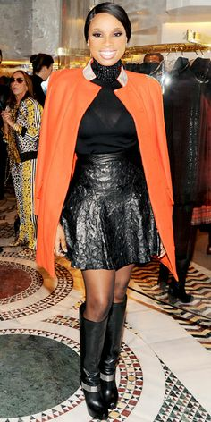 Jennifer Hudson helped open Versace's Soho boutique in an edgy ensemble that included a leather skirt, bright topper and knee-high boots.