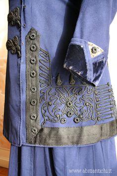 Costume in blue cloth with frogs and braiding. Collar in velvet black. Abiti Antichi- abito 38