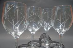 Etched wine glasses with birds in trees. Unique design has 1,2,3 or 4 birds so it has a built in charm! Hand drawn and etched design by lovealush. Set of 4 $49.95
