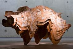 Tony Craggs sculpture Caught Dreaming (2006) exhibited in Museum Beelden aan Zee, The Hague. The work is made out of Jesmonite and somehow resembles the body a rhinoceros. As Cragg puts it himself: it forms a volume of sequential profiles where the orientation of the profile remains the same but, instead of staying parallel to each other, the templates are at angles to one another and provide an impulse for the form to change direction. By Haags Uitburo