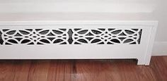 vintage-look covers for the hideous baseboard heaters in the bathrooms