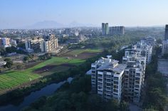 Lush green grass & mountain view from #GuruAtman towers