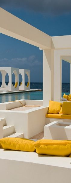This super trendy beach club (without a beach) is in Pietermaai, Willemstad, Curaçao. Its architecture and colors against the blue sky and Caribbean Sea designed by Paskalle Kruyssen. Willemstad, Beach Club, Ocean Club, Outdoor Spaces, Outdoor Living, Casa Patio, Gazebo, Relax, Mellow Yellow