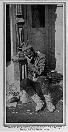 Serbian soldier, slowly dying of typhus on the door steps of the hospital to which he has been refused admittance because it is already overcrowded with typhus patients - WWI