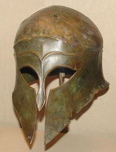 Corinthian bronze helm from the trove of spoils at Olympia, c. 460 BC. The inscription on the lower rim tells that the Argives took it from the Corinthians in battle and, in gratitude, dedicated it to Zeus.