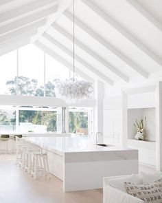 Waking up to this every morning may just be on everyones wishlist | @threebirdsrenovations have gone next-level for #bonniesdreamhome | A faultless kitchen sitting pretty with Caesarstone Statuario Maximus in a mitred apron edge that goes on forever  Were in love with the level of detail @carrerabydesign have gone through to seamlessly integrate all the appliances within this space     #caesarstoneau #caesarstone #statuariomaximus #moderncoastalbarn #threebirdsrenoeight