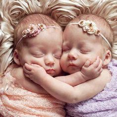 Baby girls with flowered headbands
