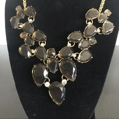 Statement Necklace Smokey black /grey crystals placed in gold tone setting makes this necklace a stunner! Jewelry Necklaces