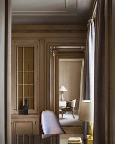Such a perfect enfilade with a Gustavian Chair As Focus in this calming, elegant, beautifully panelled Room by @stephensillsassociates - Timeless, tailored chic-Every Item is carefuly curated and placed-it is a very disciplined approach, but oh, does it pay! #@horschinteriors #designersweadmire #stephensills #fromourpinterestboard #neoclassicism #updated #elegance #neutral #boiserie #panelling #linenandcashmere #gustavian #gustavianrocks #antiquesarecool #antiquesaretimeless