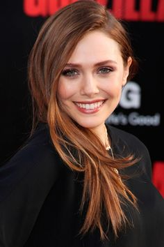 Elizabeth Olsen Sweeps Her Chocolate Locks To The Side For The Godzilla Film Premiere In LA, 2014