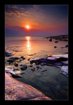 Veil of Sun.  Shot taken in Porkkala (a point outside Helsinki in Finland) at sunset | © Paavo ~ Solkku