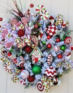 This large traditional Christmas wreath is beautiful and a stunning welcome to all. With a candy house and candy picks, the primary colors of red, green, and wh Large Christmas Wreath, Holiday Wreaths, Christmas Time, Christmas Crafts, Christmas Decorations, Christmas Ornaments, Holiday Decor, Christmas Windows, Winter Wreaths