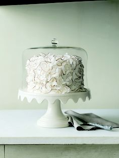An old-fashioned cake stand with a pretty scalloped edge. $79.99