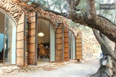 3 Arched entry ways let the afternoon sun stream in through the olive leaves.   cavehouse via airbnb