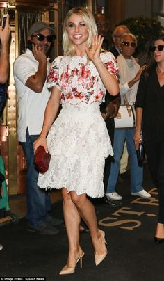 Eye-catching: Julianne Hough sported a demure, lace skirt with a brightly colored short-sl...