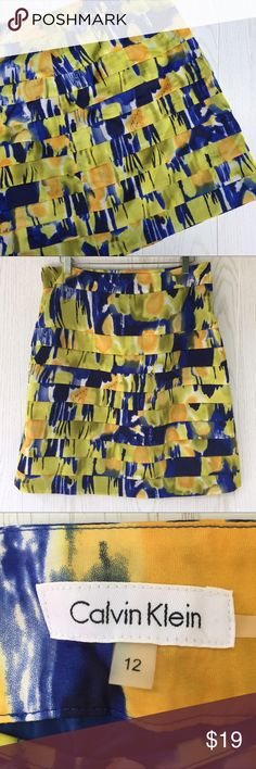 """Calvin Klein Tiered Print Skirt Calvin Klein Tiered Print Skirt • beautiful bold colors for spring and summer • tiered design • side zip • 16.5"""" waist • 22"""" length • lined  great condition 😊 Calvin Klein Skirts Midi"""