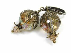 12mm multi-faceted firepolished Czech glass rounds in Honey Luster with sparkling Swarovski crystal bicones in Light Colorado Topaz and antiqued brass bead caps. www.etsy.com/... #jewelry #earrings #vintage style
