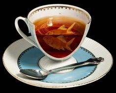 a Mad Hatter's tea cup - i would like one..  to defy physics before lunchtime everyday?  yes, please :)