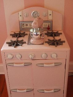 """Her retro play-stove from Pottery Barn Kids…"" Vintage play stove"