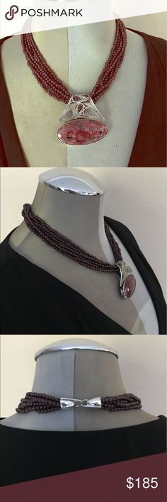 """statement necklaces Rhodonite stone glass beads Beautiful statement necklaces with Rhodonite center stone! Pre owned pristine condition!!  Necklace features  • Large Rhodonite center stone  • 6 purple glass beaded strands  • Silver slide pendant  • Hook and eye closure  • 17 1/2"""" long  • Preowned pristine condition    MT 6209  Visit our Jewelry Collection at E-Couture Jewelry Necklaces"""