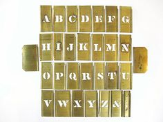 Vintage brass letter stencils in the Gothic style. Includes a full alphabet from A through Z, a period, an &, and two end pieces. These are narrow with