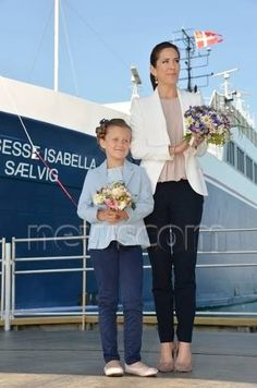 "Princess Isabella was in good moo when she did her first official task, - with bravura-smile and scissors in her hand, 8-year-old Isabella cut the string that hold the bottle of Samsoe blackcurrant juice naming the ship ""Princess Isabella"". Isabella took plenty of time, along with her mother, to greet all the many attendees"
