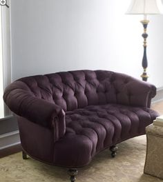SMOKIN' HOT TUFTED...... Sofa?  Sofa doesn't seem fitting for this exquisite piece.  Bet prince would be diggin on this!