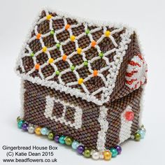 Make a gingerbread house in the form of a beaded box. You will be using Peyote stitch and simple netting for this project and working with seed beads.