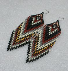 Beautiful beaded dangle peyote earrings with fringe.Native American style, Boho style. Earrings made from Czech beads. Surgical Steel ear wires. Measurements: Length - 14 cm (including ear wires) Width - 4 cm More earrings here http://www.etsy.com/shop/Olisava?section_id=14128476