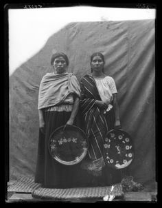 ID: CL2479Tarasco Indian women holding large decorated plates, Michoacán, 1896