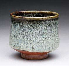 tea bowl with dark brown black, wood ash and shino glazes