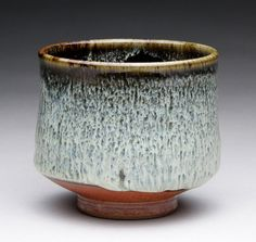 tea bowl with dark brown black, wood ash and shino glazes