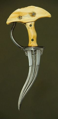 Khanjarli Dagger Dated: probably 18th century Culture: Indian Medium: Damascus steel, bone or ivory