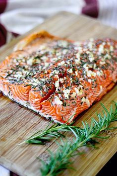 Rosemary and Garlic Roasted Salmon  2 garlic cloves 2 fresh 6″ rosemary sprigs, about 1 tablespoon chopped 1 1/2 to 2 pounds salmon, prefera...