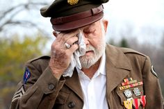 """Morris Finney Jr. wipes away tears as he listens to a bugler play """"God Bless America"""" at Beachwood Cemetery at 11am, November 11th, 2012. Finney, 89, served in the Army and fought in New Guinea, the Phiippines and Japan during WWII. His uncle, he says, served in Europe while Finney was in the Pacific. His uncle was shot and killed off the Bay of Biscay. Beachwood held their very first Veterans Day ceremony at the historic cemetery on Green Rd at Haliburton. (Lynn Ischay/The Plain Dealer)"""