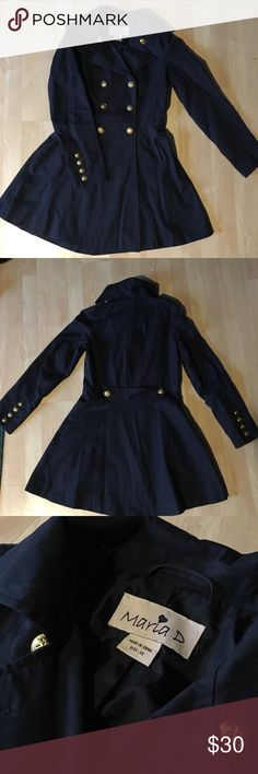 Navy trench coat with nautical accents Cinched navy trench coat. All buttons have a nautical anchor on them. Missing one button on the inside. Will include two original replacement buttons with order. Only worn a few times. In good condition. maria d Jackets & Coats Trench Coats