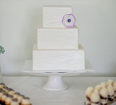 3 Tier Square White Wedding Cake Decorated with Black and Ivory ...