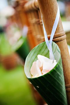 Stylist's Tip: At a tropical wedding, ask your planner or florist to provide rose petals in banana leaf cones as unique confetti for guests to throw. Image: Photo Factory Bali.