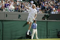 Sam Querrey, ranked 28th, celebrates winning his third-round Wimbledon match against top seed and defending...