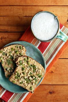 Sprouted grain bread topped with almond butter,... | Garden of Vegan