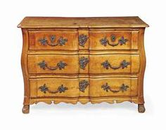 A LOUIS XV PROVINCIAL CHERRYWOOD COMMODE EN ARBALETE MID 18TH CENTURY