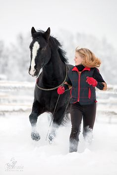 A young girl & her horse in the deep Snow .